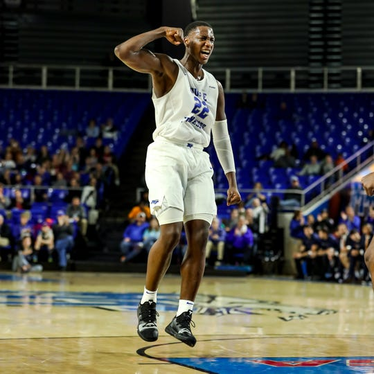 MTSU forward Reggie Scurry reacts to a play during the Blue Raiders' 75-72 win over UTEP on Saturday.
