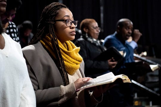 Alisa Walter, of Nashville, reads from her Bible during a Watson Grove Missionary Baptist Church service at the AMC Thoroughbred 20 theater in Franklin on Sunday, Jan. 20, 2019.
