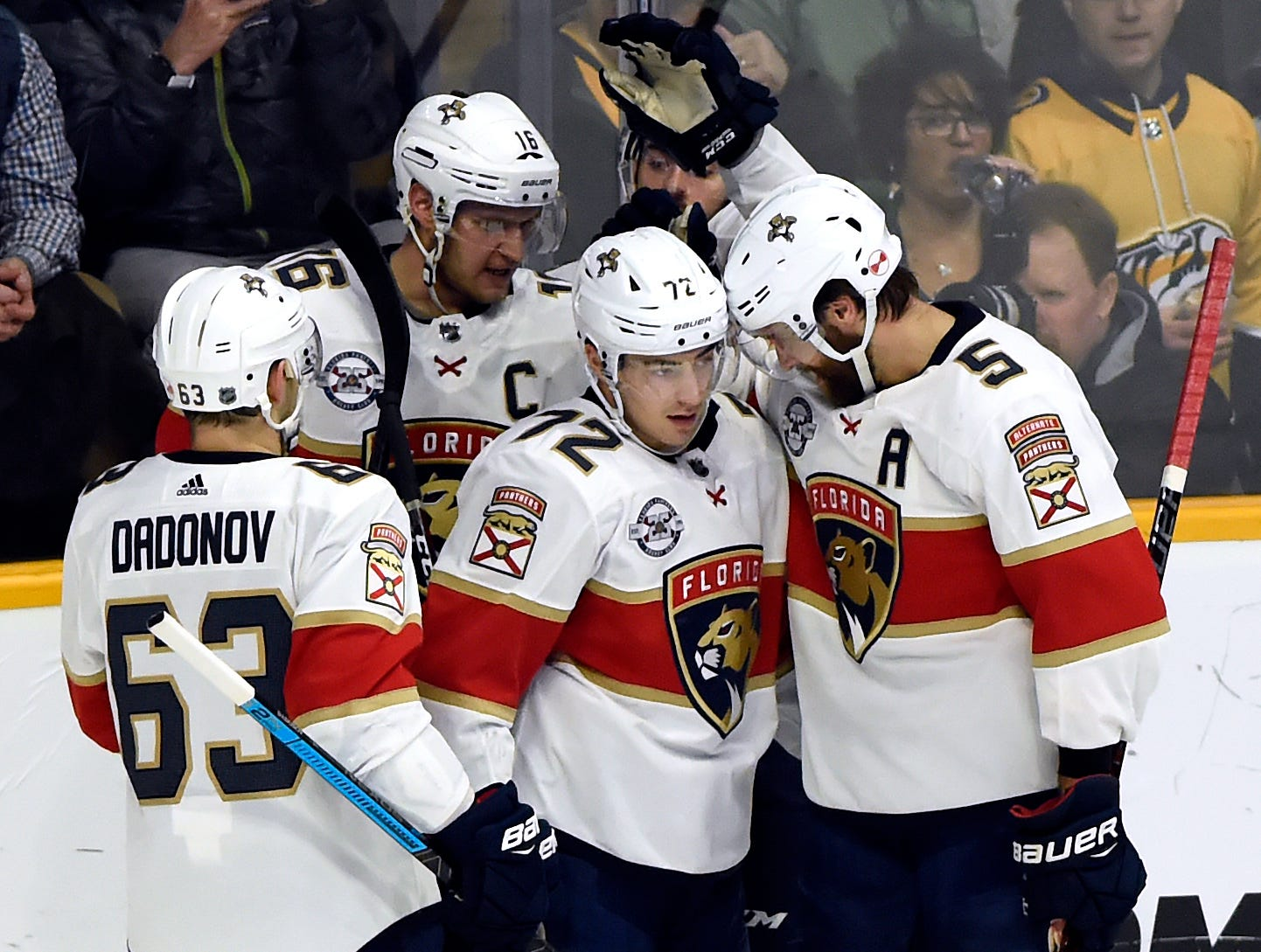 Florida Panthers center Frank Vatrano (72) celebrates with teammates after scoring a goal against the Nashville Predators during the first period of an NHL hockey game Saturday, Jan. 19, 2019, in Nashville, Tenn.
