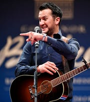 Luke Bryan speaks before he performs during the First Couple's Inaugural Dinner and Ball in the Music City Center Grand Ballroom in downtown Nashville Saturday, Jan. 19, 2019.