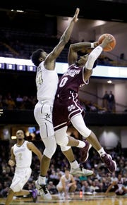 Mississippi State guard Nick Weatherspoon (0) drives against Vanderbilt forward Aaron Nesmith (24) in the first half of an NCAA college basketball game Saturday, Jan. 19, 2019, in Nashville, Tenn.