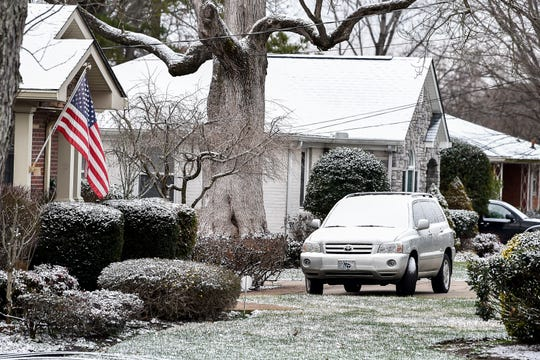 A light coating of snow covers a car in the Donelson neighborhood of Nashville, Tenn., early in the morning on Sunday, Jan. 20, 2019.