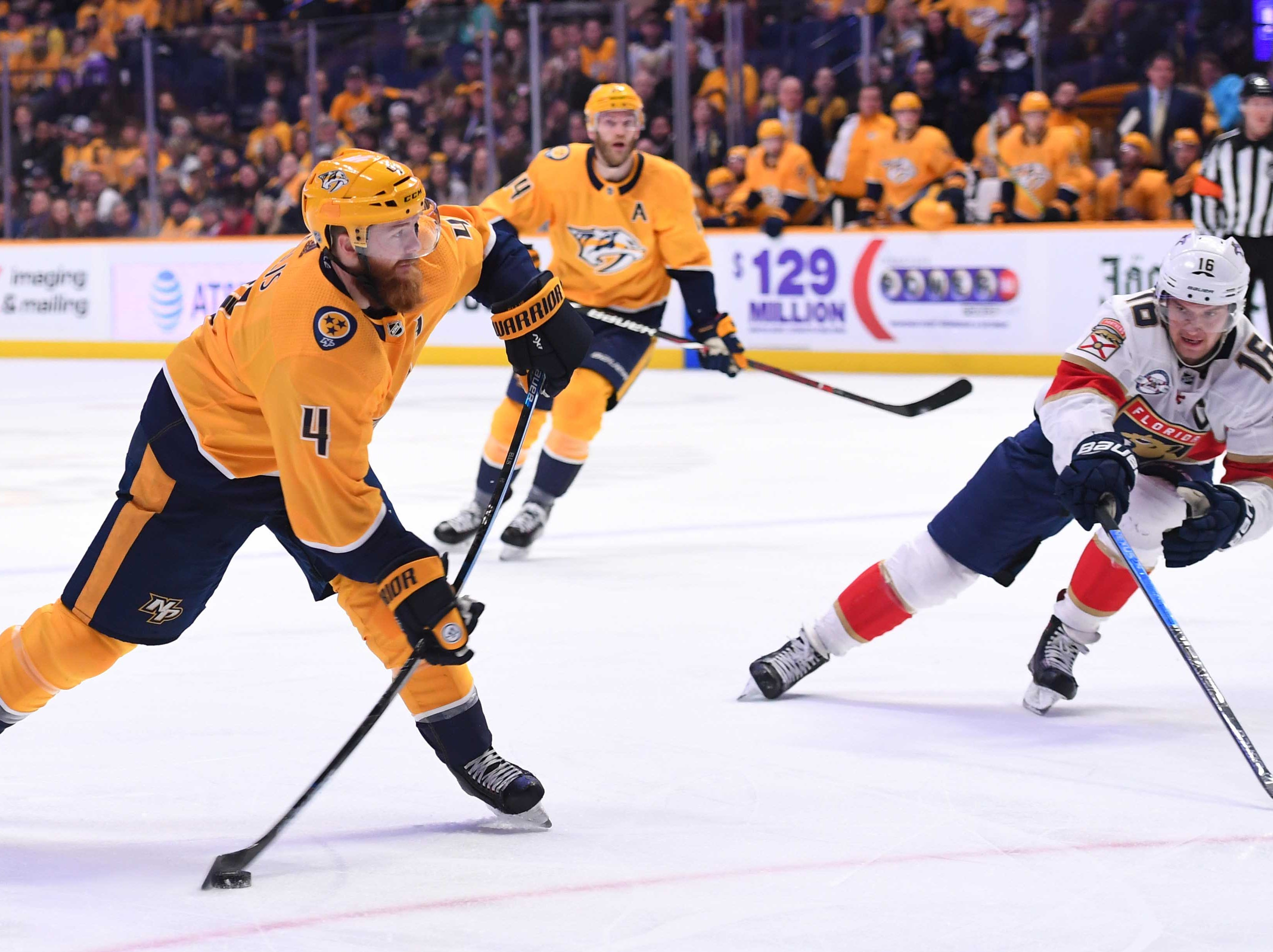 Nashville Predators defenseman Ryan Ellis (4) attempts a shot during the first period against the Florida Panthers at Bridgestone Arena.