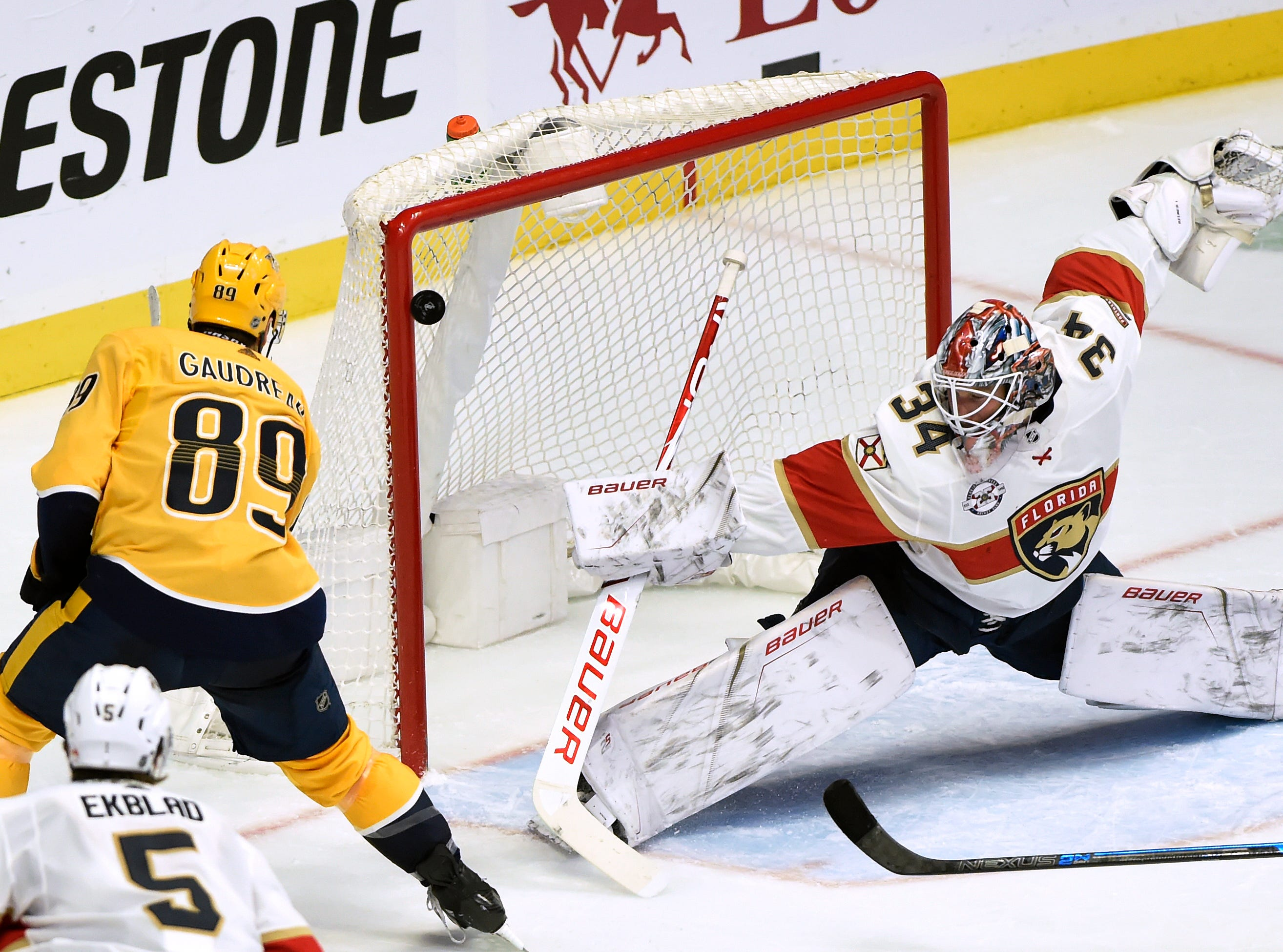 Nashville Predators center Frederick Gaudreau (89) shoots the puck off the goal post as Florida Panthers goaltender James Reimer (34) defends during the second period of an NHL hockey game Saturday, Jan. 19, 2019, in Nashville, Tenn.