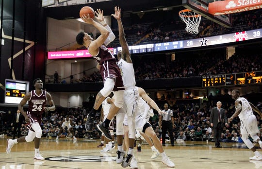 Mississippi State guard Quinndary Weatherspoon (11) shoots over Vanderbilt forward Aaron Nesmith (24) in the second half of an NCAA college basketball game Saturday, Jan. 19, 2019, in Nashville, Tenn.