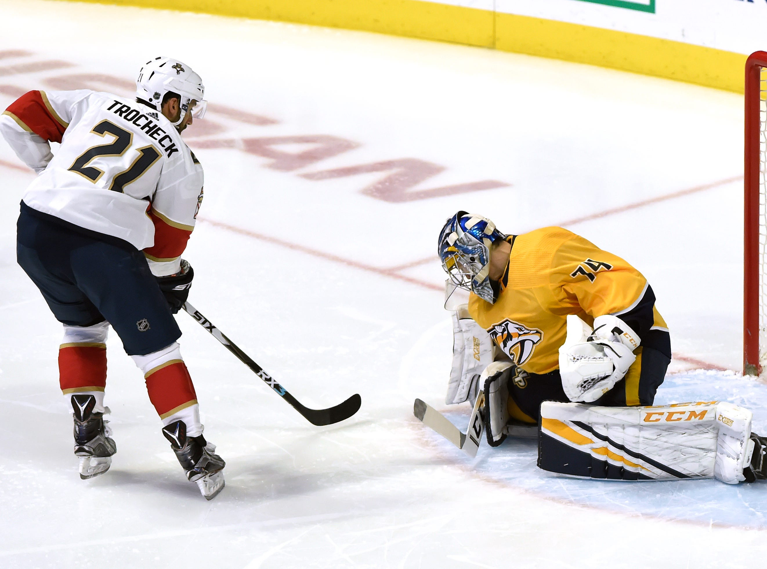 Florida Panthers center Vincent Trocheck (21) scores a goal against Nashville Predators goaltender Juuse Saros (74) during the second period of an NHL hockey game Saturday, Jan. 19, 2019, in Nashville, Tenn.