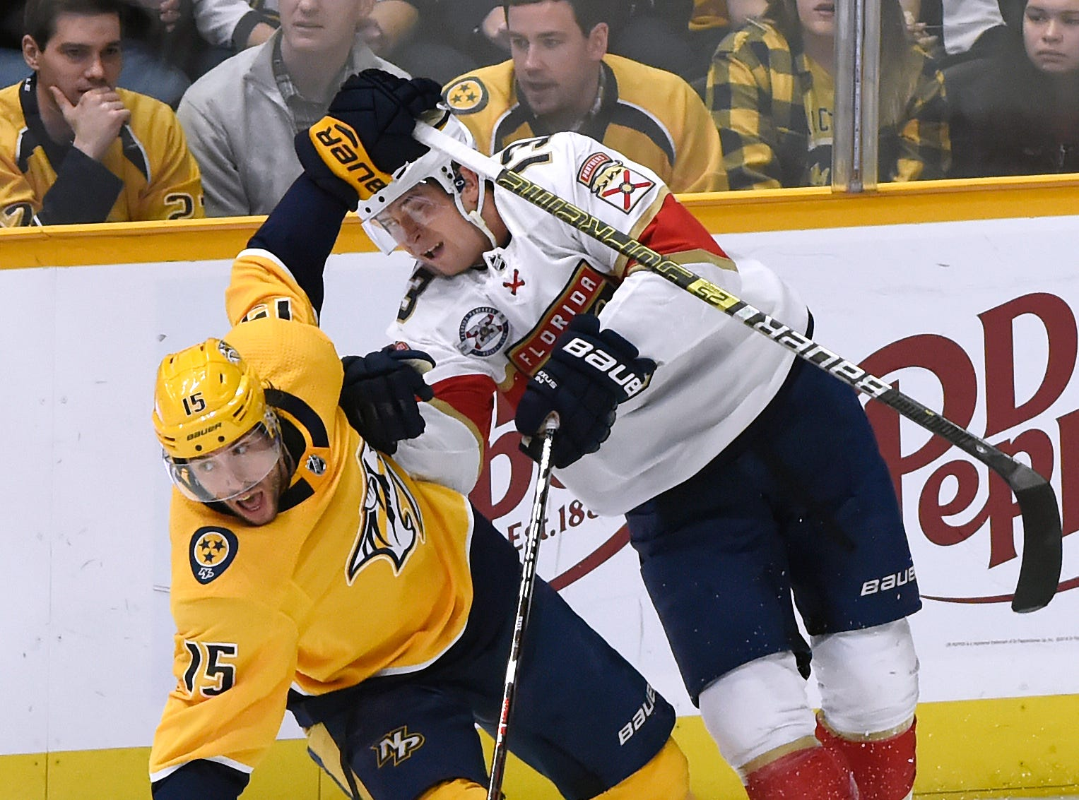 Florida Panthers defenseman Mark Pysyk (13) collides with Nashville Predators right wing Craig Smith (15) during the first period of an NHL hockey game Saturday, Jan. 19, 2019, in Nashville, Tenn.