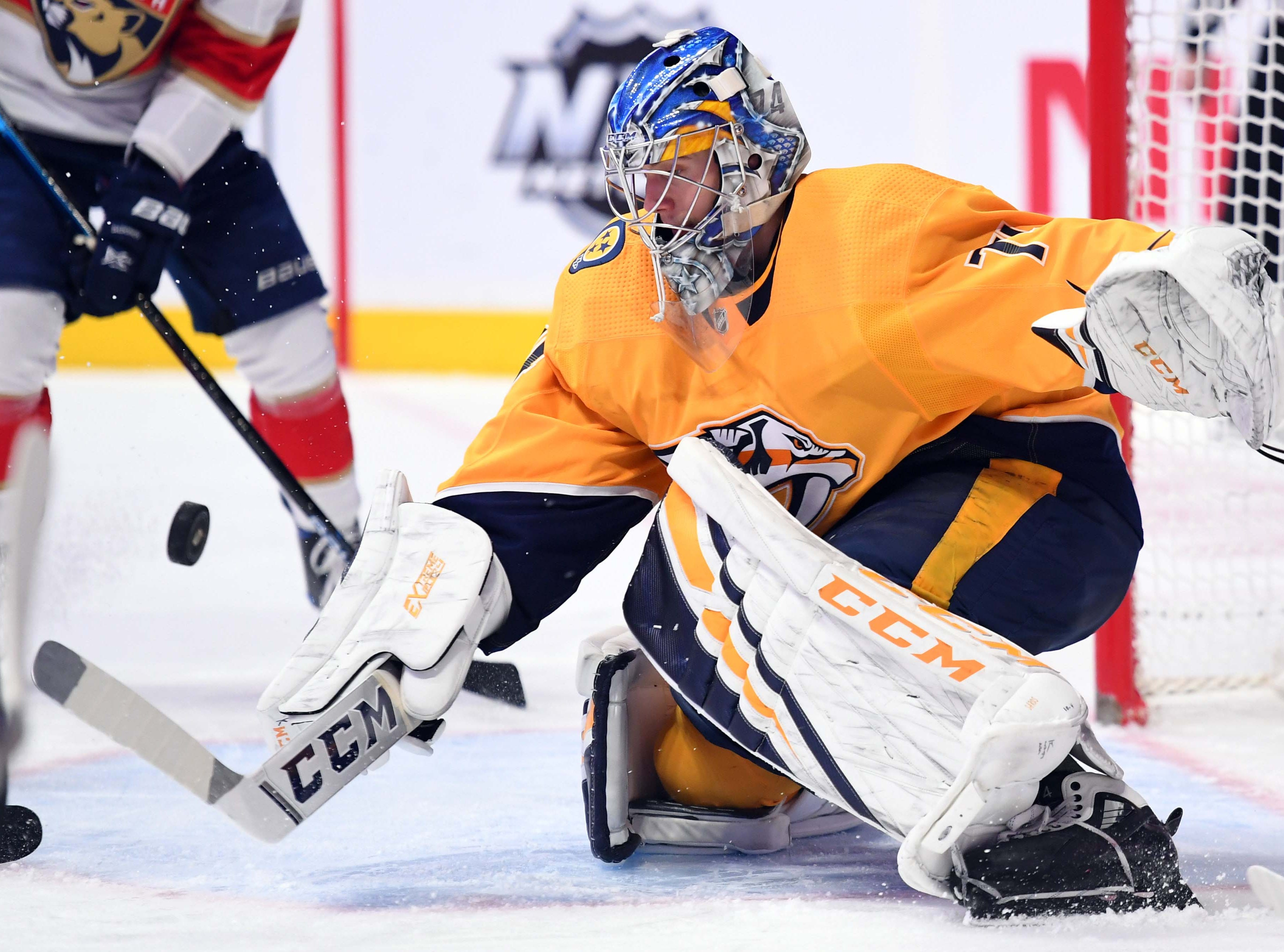 Nashville Predators goaltender Juuse Saros (74) makes a save during the second period against the Florida Panthers at Bridgestone Arena.