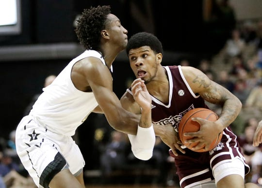 Mississippi State guard Lamar Peters, right, drives against Vanderbilt guard Saben Lee in the first half of an NCAA college basketball game Saturday, Jan. 19, 2019, in Nashville, Tenn.