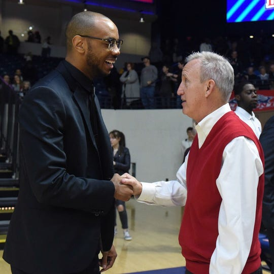 """Former Belmont standout Brian """"Penny"""" Collins, now the coach at Tennessee State, and Belmont coach Rick Byrd talk before Saturday's game at Curb Event Center."""