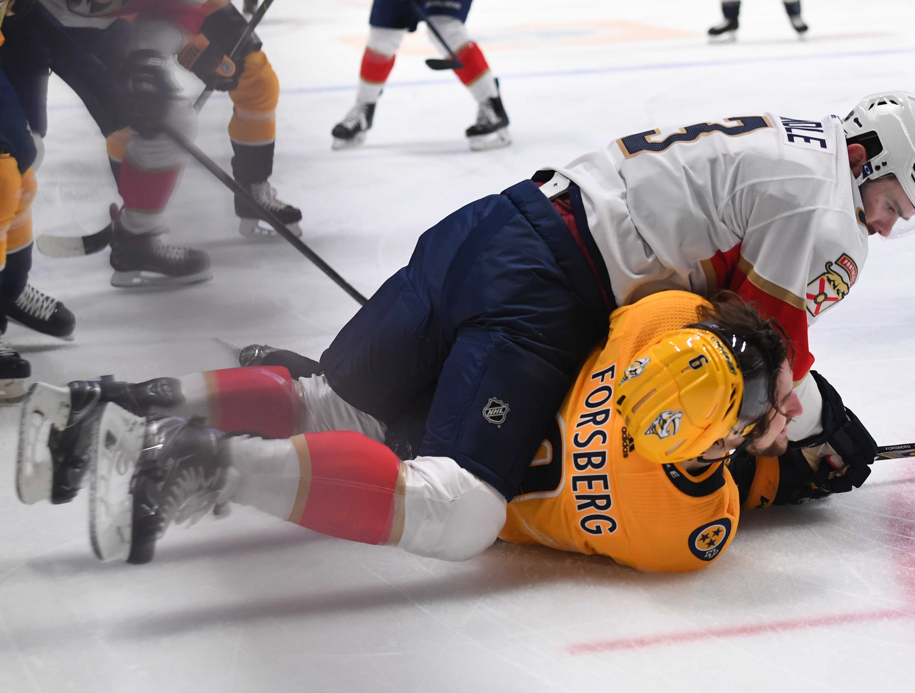 Florida Panthers defenseman Keith Yandle (3) hits Nashville Predators left wing Filip Forsberg (9) as he lays on the ice during the first period at Bridgestone Arena.
