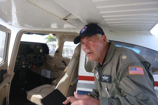 Maj. Richard Farmer, pilot with the Civil Air Patrol, shows the interior of a Cessna 172, one of the group's aircraft.