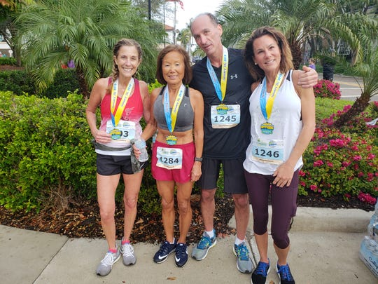 Five members of the Northeast Running Club from Cleveland, Ohio, competed in the Naples Daily News Half Marathon on Sunday. From left, Reggie LaVan, part-time Bonita Springs resident Jeannie Rice, Craig Pulling, and Denise Pulling. The fifth, Angela Pohl, is not pictured.