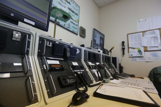 The communications hub allows Civil Air Patrol crew members to relay information from aircraft to ground crews from inside a Marco Island Executive Airport building.