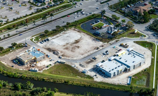A retail strip to be anchored by Dollar Tree, lower right, and a freestanding building for Tire Kingdom, left, are under construction at Price Street Plaza fronting U.S. 41 East in East Naples. A Wawa store and gas station will be built on the lot in the center of the plaza.