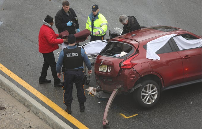 The body of the driver of this Nissan is covered in a blanket after already being covered by a white sheet on the Garden State Parkway Sunday afternoon, January 20, 2019.  The fatal accident occurred on the north-bound lanes in Clifton.