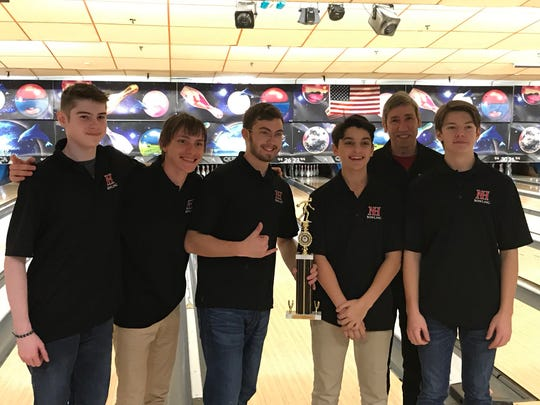 Northern Highlands junior Jake Sedor (with trophy) is joined by teammates and coach Bob Tschinkel after shooting a 289 to earn the high game award at the Bergen County boys bowling tournament on Saturday, Jan. 19, 2019.