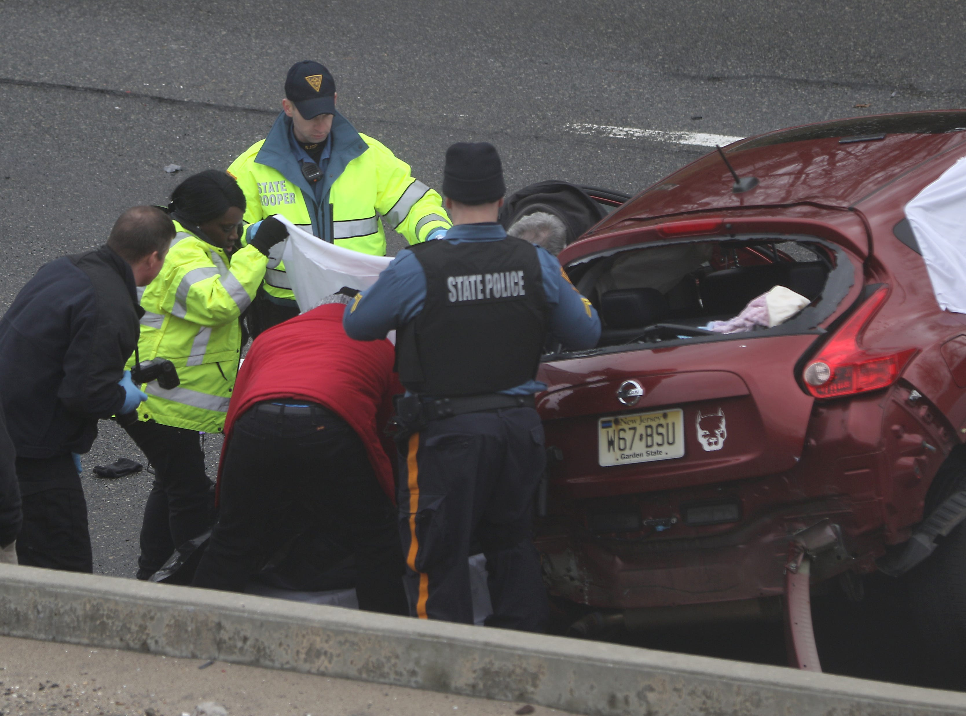 State Police and other emergency officials are shown beside a driver who lost their life on the Garden State Parkway, in Clifton. Sunday, January 20, 2019