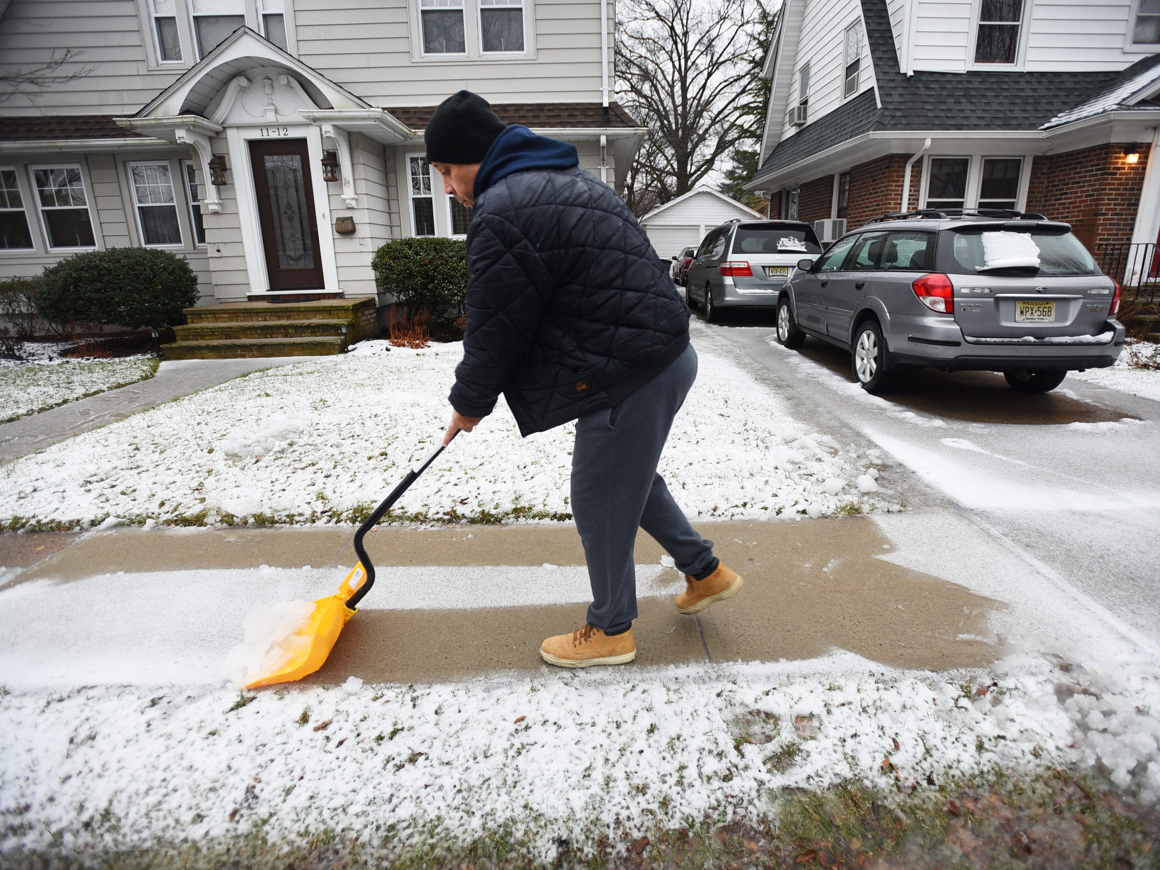 John Figueroa of Fair Lawn, shovels snow from the sidewalk outside of his home on Sunday morning in Fair Lawn, NJ on 01/20/19.
