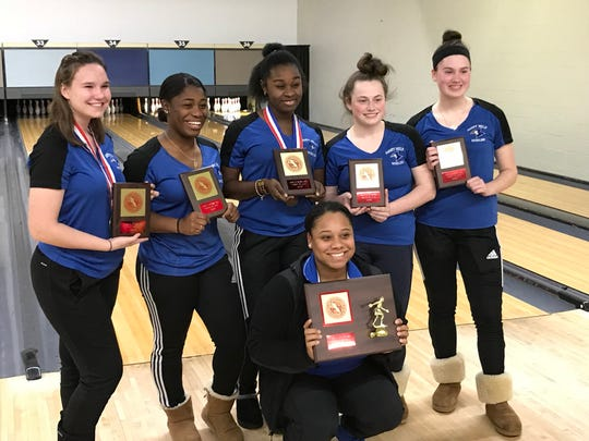 Mary Help of Christians captured the Passaic County girls bowling championship on Friday, Jan. 18, 2019 at Parkway Lanes in Elmwood Park. Standing, from left: Audrey McMillin, Bryonna Richburg, Alleyna Jean-Philippe, Kayla Sullivan and Samantha Susen. Kneeling: Coach Anita Muthee.