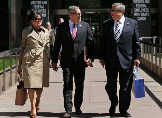 Michael Wildes, center, with the parents of first lady Melania Trump, Amalija and Viktor Knavs, in New York in May.