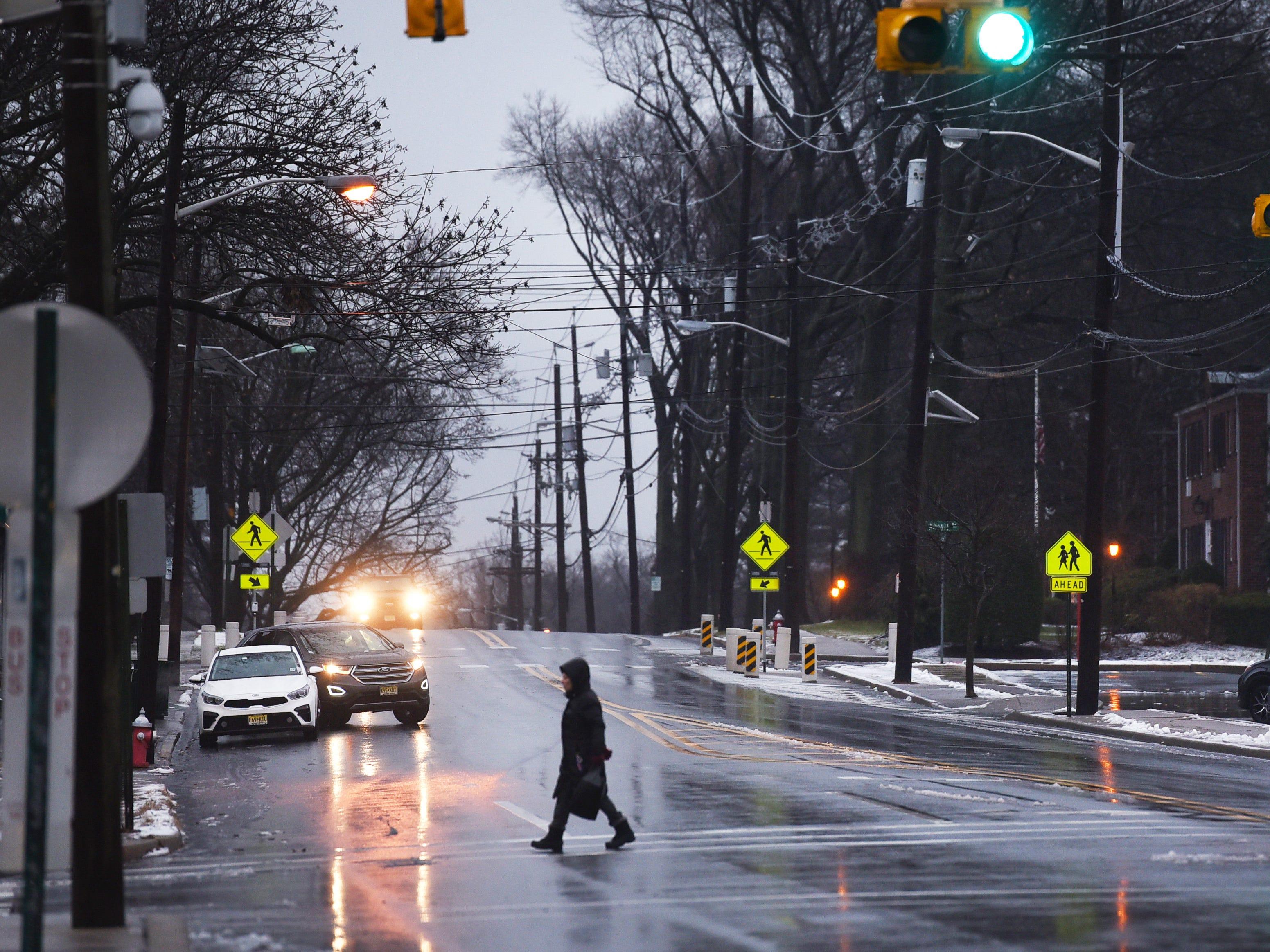 A pedestrian crosses Fair Lawn Avenue on Sunday morning in Fair Lawn, NJ on 01/20/19.