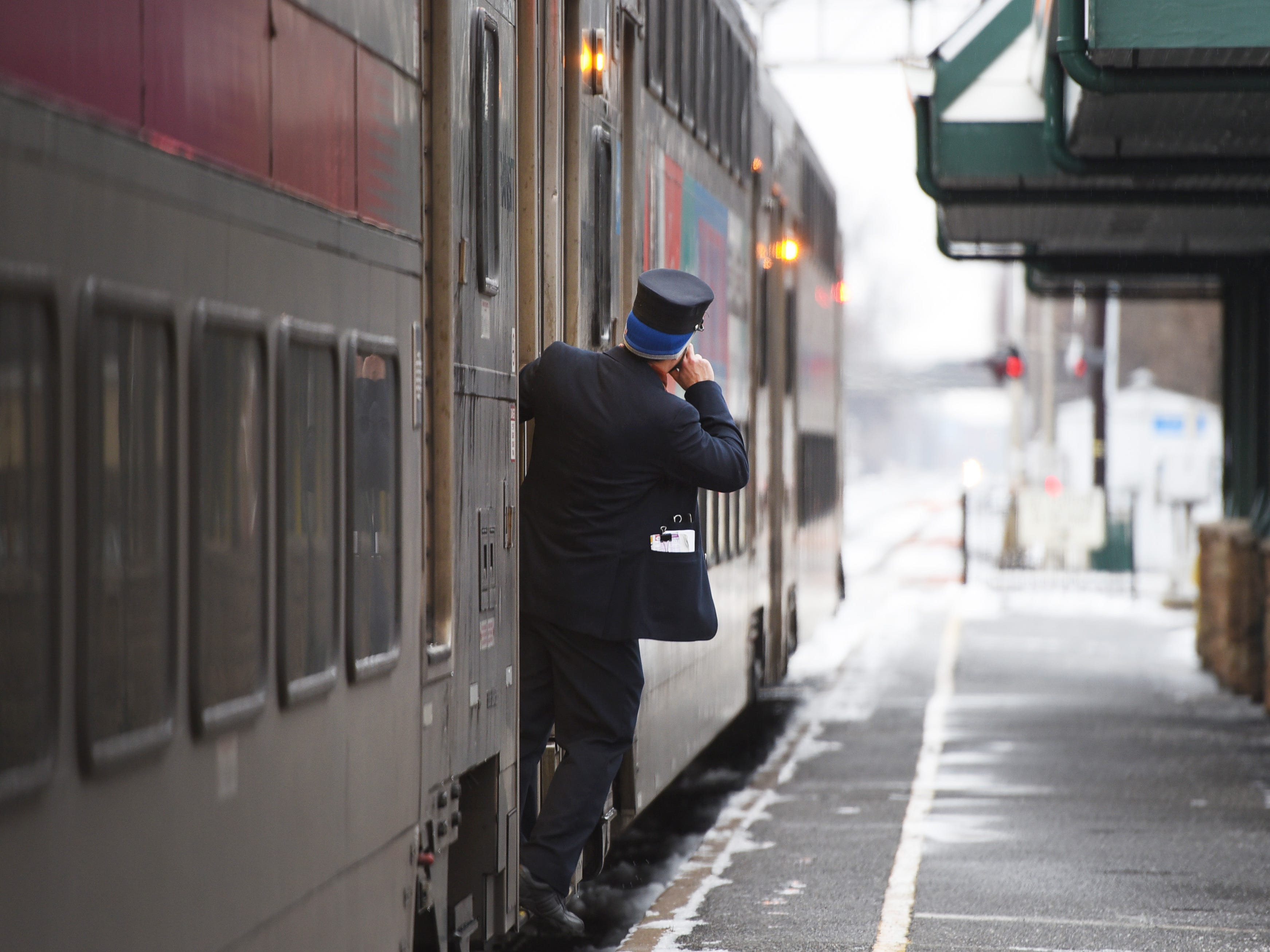 A conductor checks prior to boarding at Radburn Station on Sunday morning in Fair Lawn, NJ on 01/20/19.