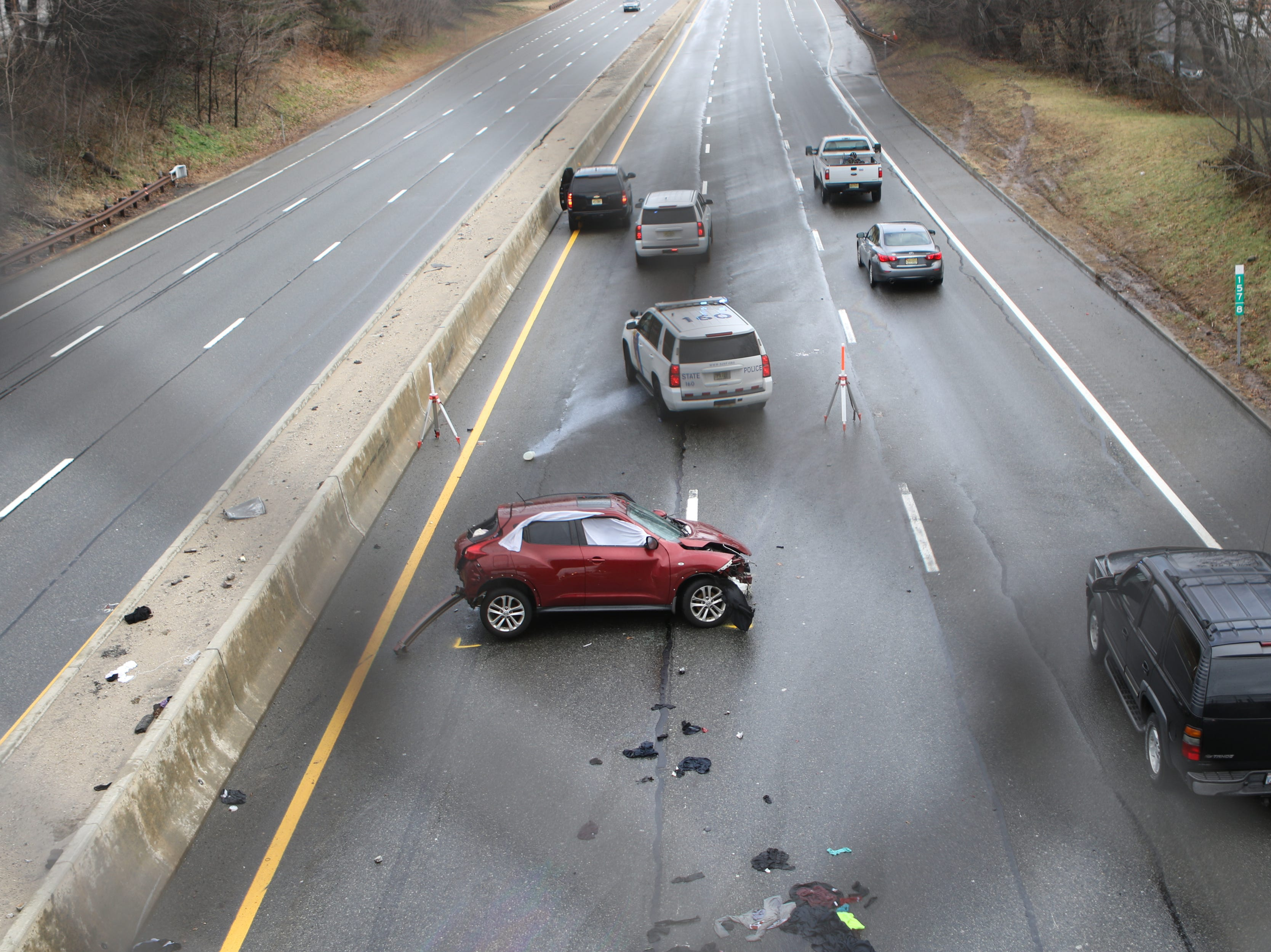A maroon Nissan is shown on the Garden State Parkway after a fatal accident in Clifton, Sunday, January 20, 2019.  Nazim Urgan (not shown), who could see the accident from his backyard, said there have been a few crashes in the same exact spot which gives him concern.