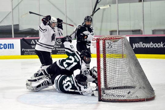 NJ PASSAIC COUNTY HOCKEY FINAL, 1/21/13 at Little Falls,  WAYNE HILLS VS. DEPAUL CATHOLIC.  Mike Crincoli of Wayne Hills (10)  scores the first goal of the game on DePaul goalie Marty McIver (40).