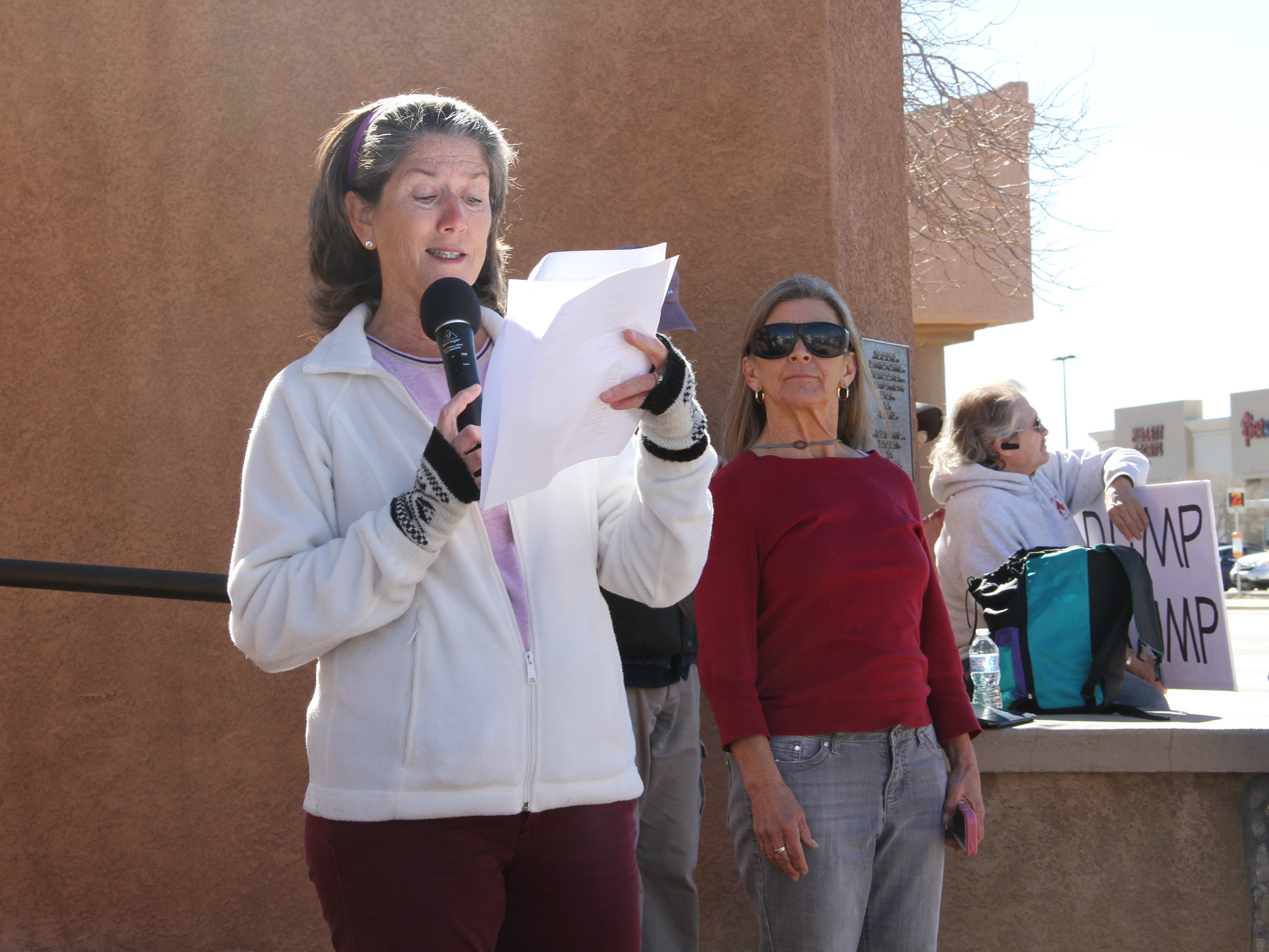 Erin O. Armendarez (L) speaks while Denise Lang (R) listens during the Alamogordo We Trust Women's march in solidarity with the national Women's March Jan. 19, 2019.
