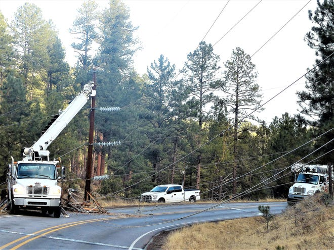 PNM crews worked on power lines after the accident at 1:46 a.m., trying to restore electricity to the village.