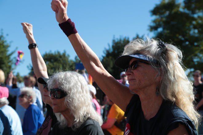 Joanie Laine, right, listens to speakers at the Coachella Valley Women's March, Palm Springs, Calif., Saturday, January 19, 2019.