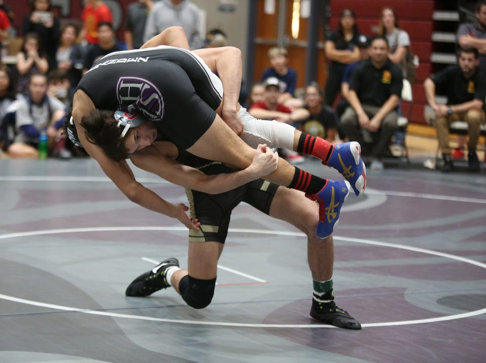 Palm Desert's Troy Mantanona takes down Shadow Hill's Isaac Chaidez during the Desert Empire League wrestling finals at Rancho Mirage High School in Rancho Mirage on Saturday, January 19, 2019.