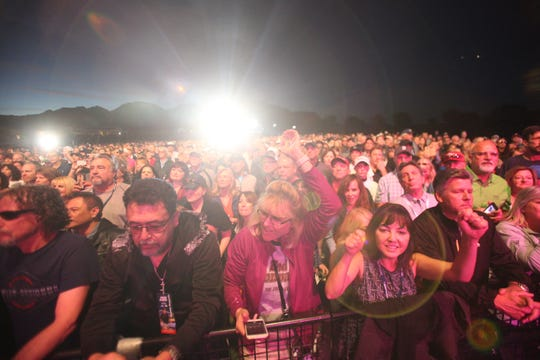 Fans of Bad Company enjoy their performance at Stadium Course at PGA West in La Quinta, California on January 19, 2019 as part of the Desert Classic golf tournament Concert Series.