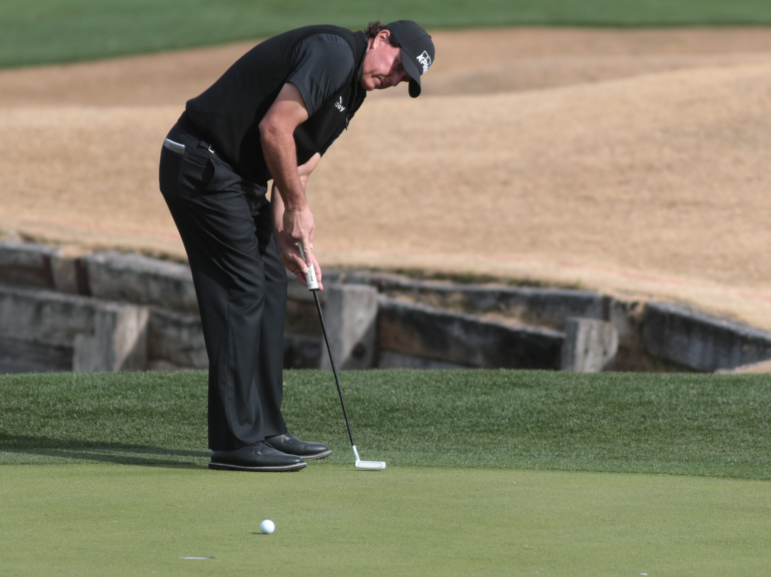Phil Mickelson putts on the 7th hole of the 2019 Desert Classic, Sunday, January 20, 2019.