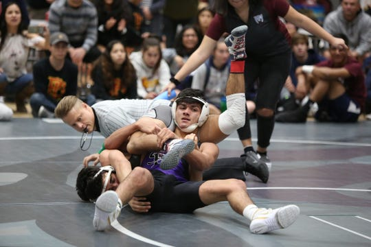 Shadow Hills' Sergio Rodriguez tangles up James Conner of Palm Desert during the 134-pound final on Saturday. Rodriguez won 17-7.