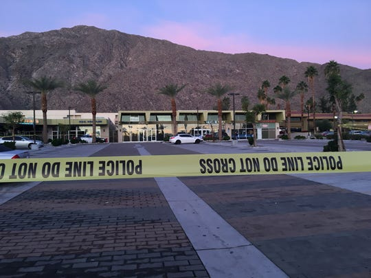 Yellow security tape surrounds a portion of the Sun Center parking lot where two people were shot early Sunday in Palm Springs.