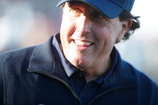Phil Mickelson is all smiles towards the end of his play at the Stadium Course at PGA West in La Quinta, California on January 19, 2019. Michelson shot a 66 in the third round of the Desert Classic golf tournament.