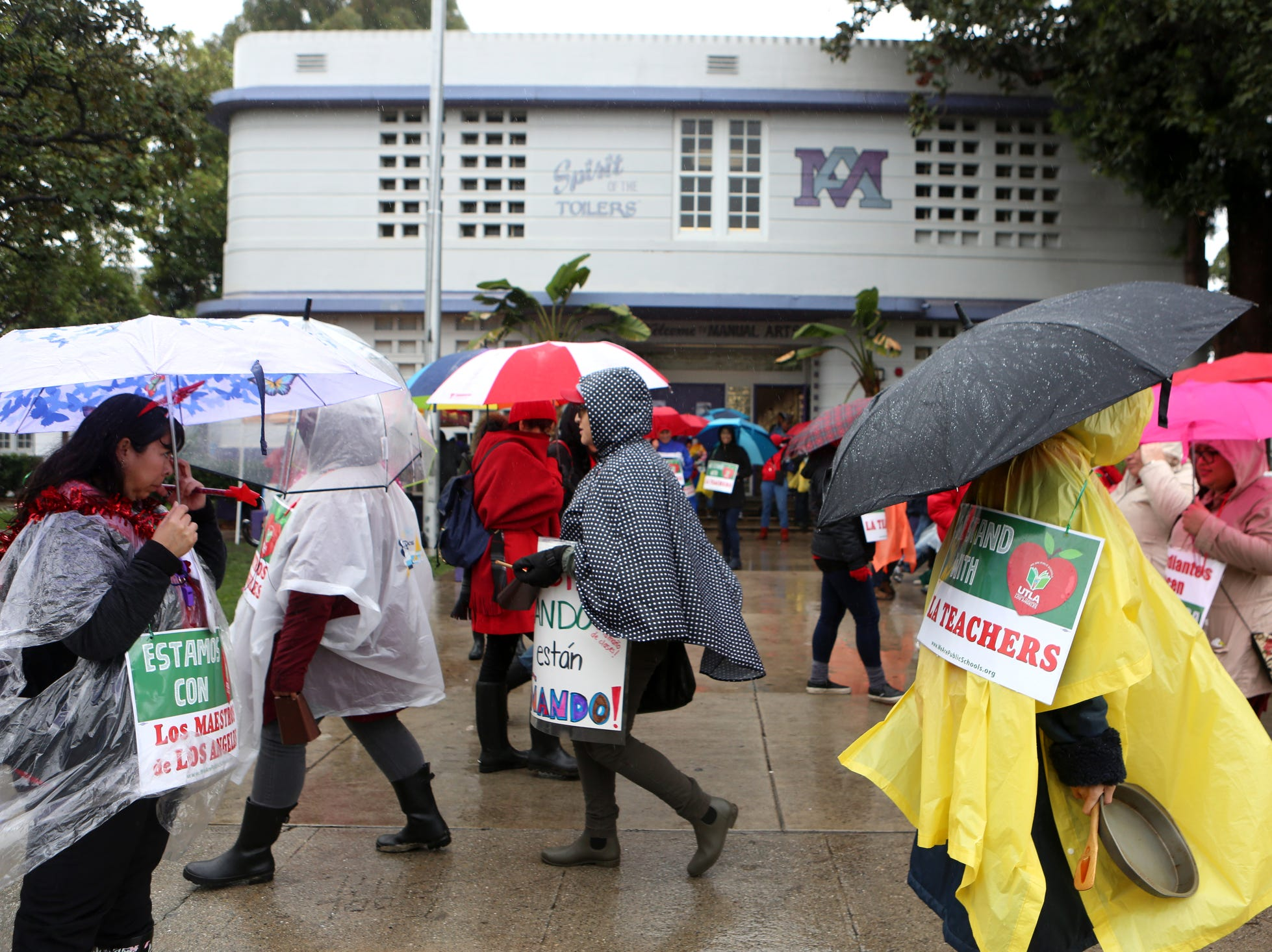 Educators and their supporters march in front of Manuel Arts High School during the third day of the United Teachers Los Angeles strike in Los Angeles on Wednesday, January 16, 2019.