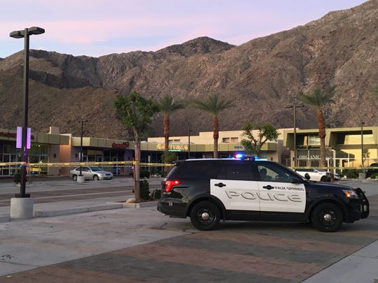 Palm Springs police surround the Sun Center parking lot where a shooting occurred early Sunday. One person died and another was injured.