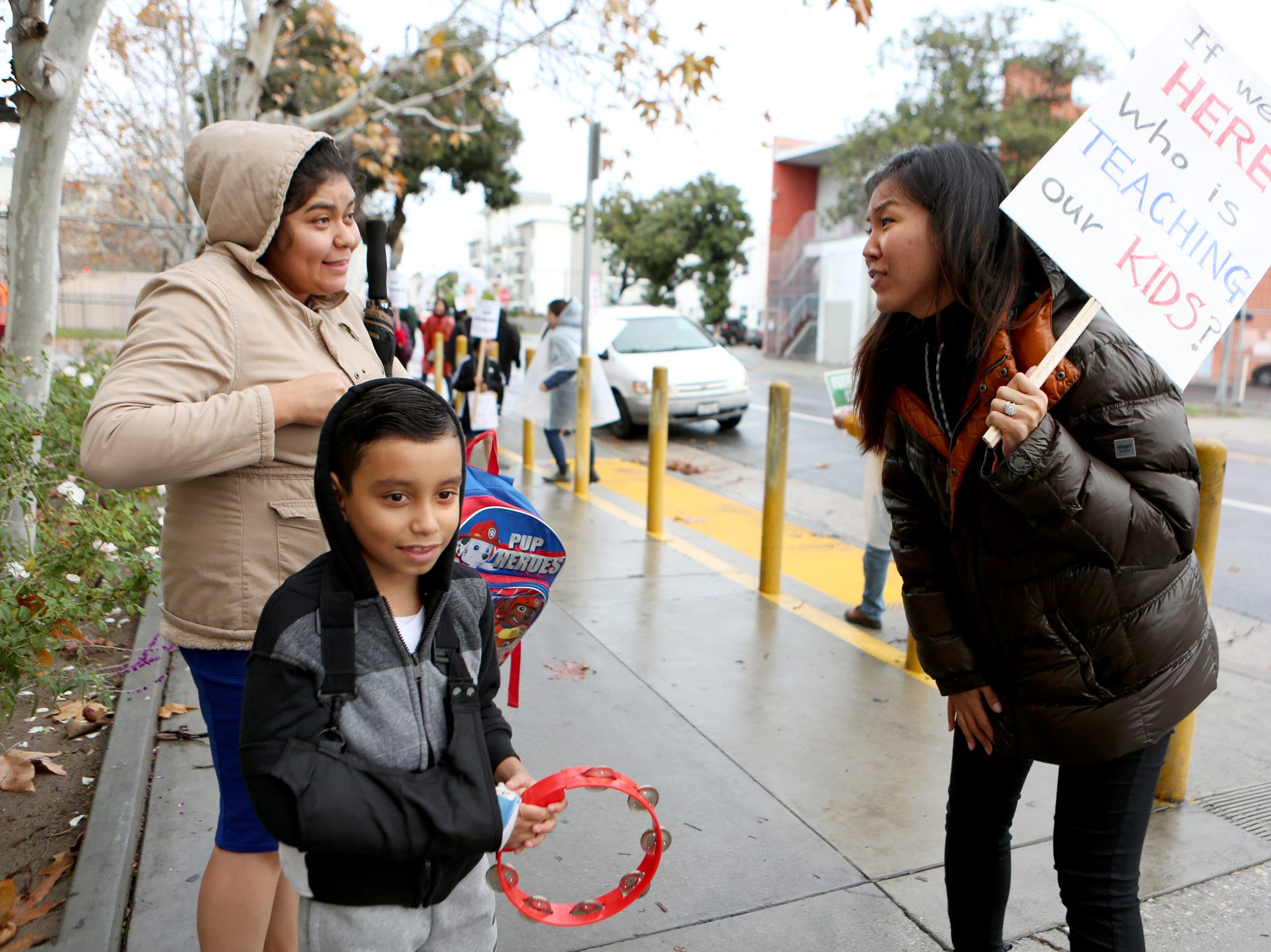 Second-grade teacher Sonia Yang, right, thanks Wendy Arias for not letting her son, Jose Ramos, cross the picket line at Charles H. Kim Elementary School during the third day of the United Teachers Los Angeles strike in Los Angeles on Wednesday, January 16, 2019.