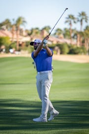 Canadian golfer Adam Hadwin hits an approach shot during the third round of the Desert Classic on Saturday at the Nicklaus Tournament Course at PGA West. Hadwin shot a 7-under 65 and is in second place, two shots behind Phil Mickelson.