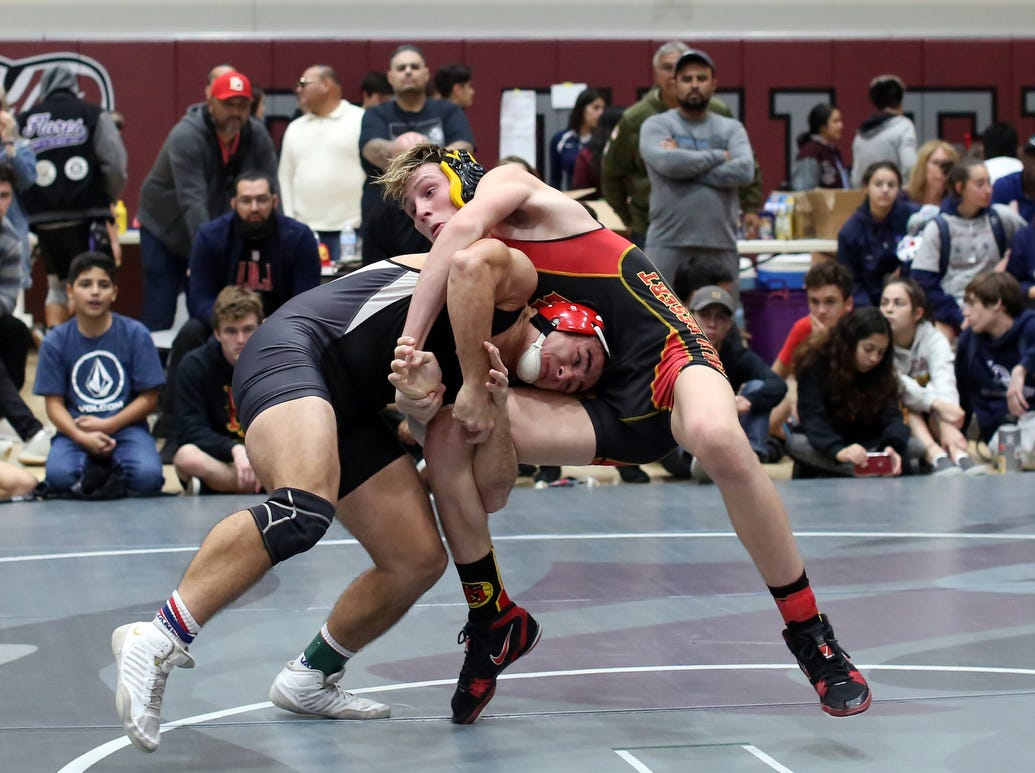 Palm Desert's Caleb Van Buskirk, right, defeated Palm Springs' James Bagget during the Desert Empire League wrestling finals at Rancho Mirage High School in Rancho Mirage on Saturday, January 19, 2019.