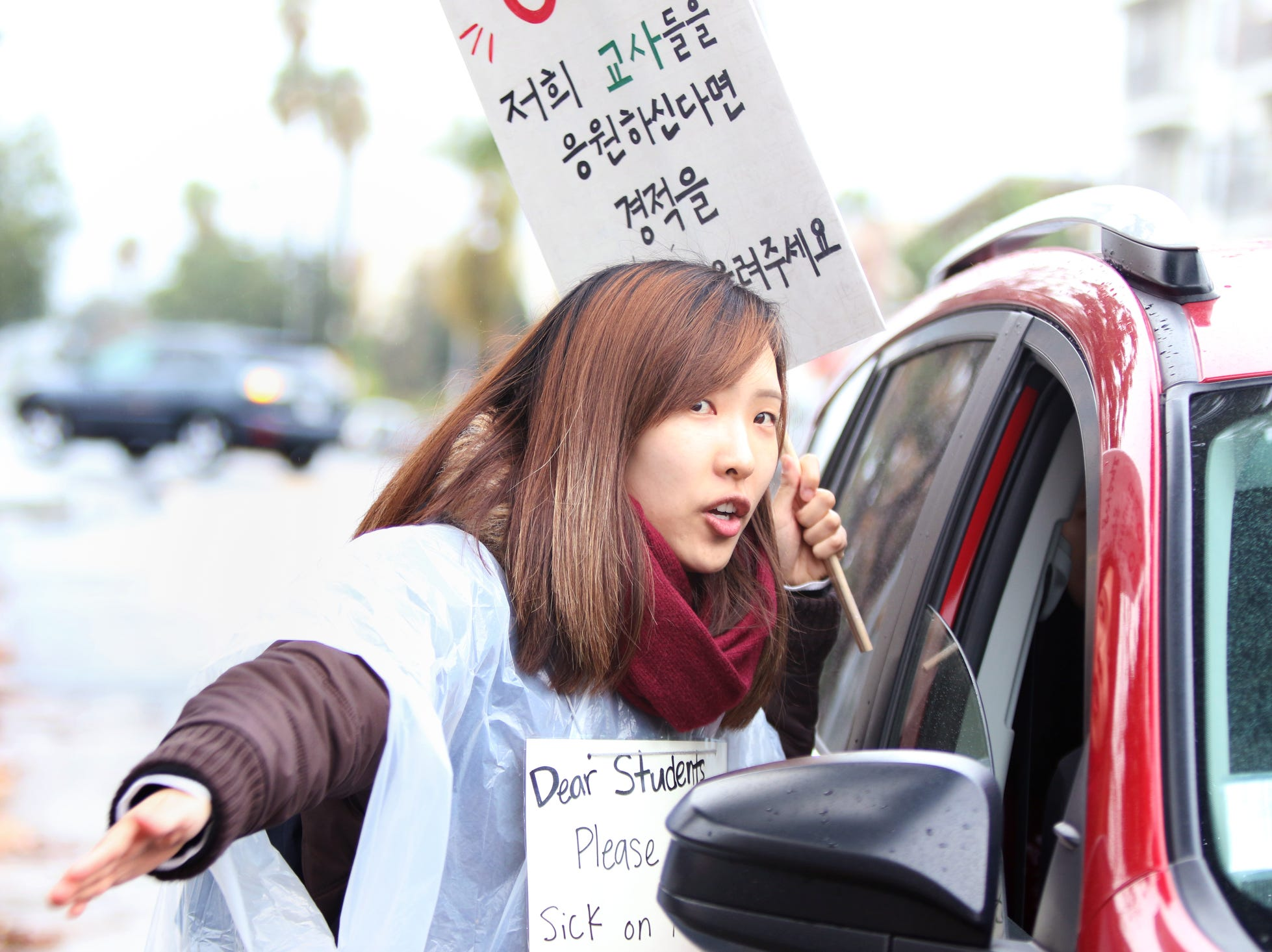 Kindergarten teacher, Hanah Lee, ask parents not to send their children to school at Charles H. Kim Elementary School on the third day of the United Teachers Los Angeles strike in Los Angeles on Wednesday, January 16, 2019.