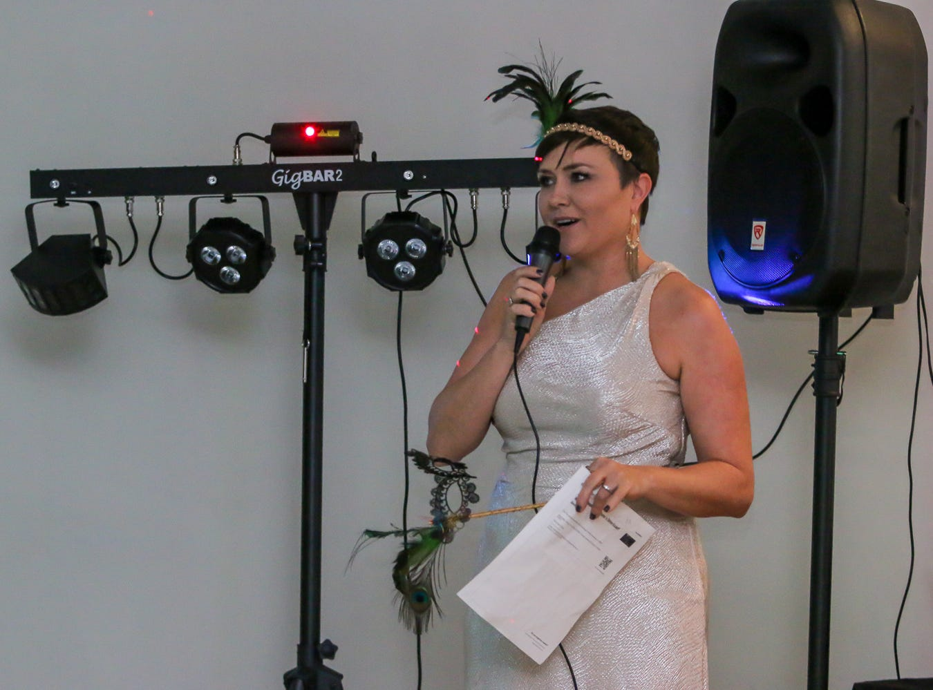Julie Still-Rolin, creator of Evolve 'n Thrive, speaks during the inaugural Gay...la Masquerade Ball at the Pensacola Grand Hotel on Saturday, January 19, 2019.