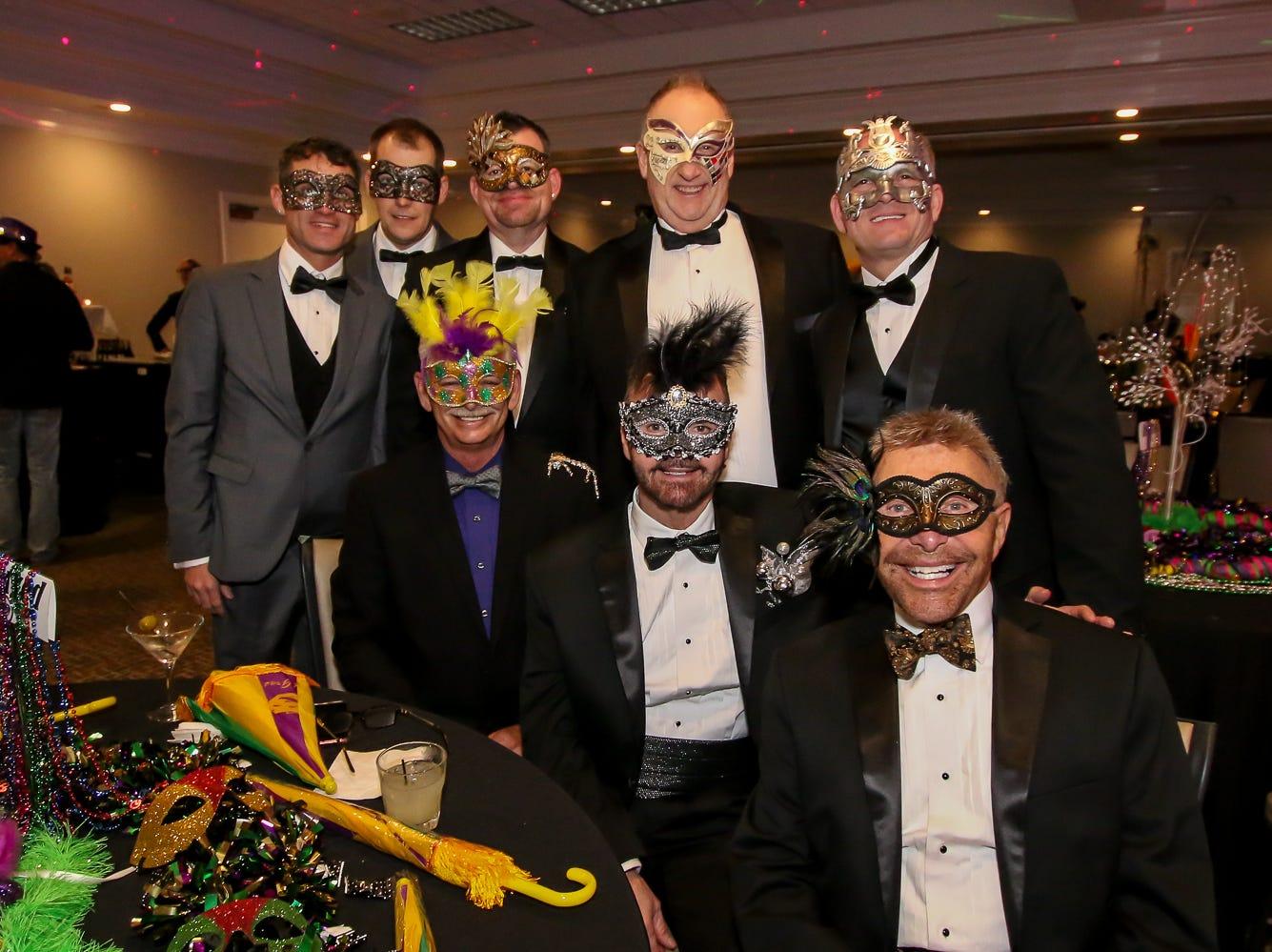 People enjoy Evolve 'n Thrive's inaugural Gay...la Masquerade Ball at the Pensacola Grand Hotel on Saturday, January 19, 2019.