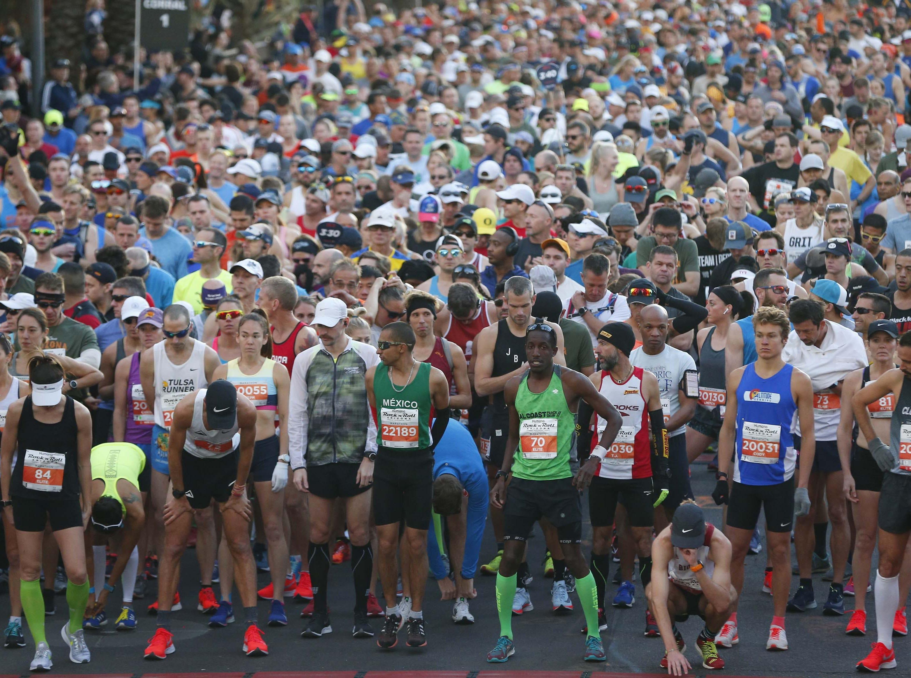 Runners wait for the start of the Rock 'n' Roll Marathon in Phoenix, Jan. 20, 2019.