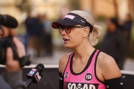 Sen. Kyrsten Sinema talks with TV stations before the Rock 'N' Roll half-marathon in Phoenix, Jan. 20, 2019.