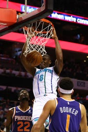 Jan 19, 2019; Charlotte, NC, USA; Charlotte Hornets center Bismack Biyombo (8) dunks the ball against the Phoenix Suns in the first half at Spectrum Center. Mandatory Credit: Jeremy Brevard-USA TODAY Sports