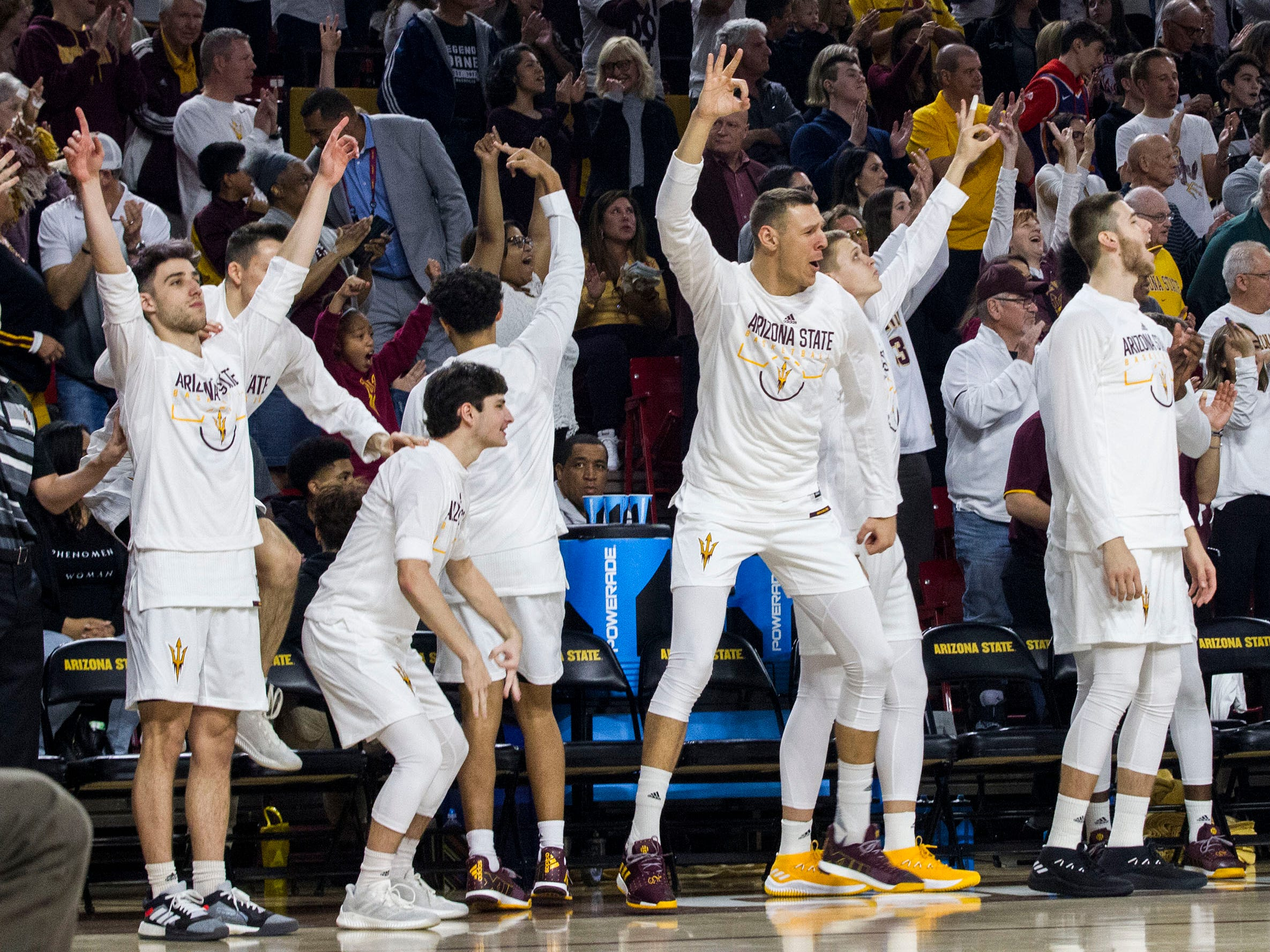 Arizona State players on the bench celebrate after a 3-point shot against Oregon during the first half, Saturday, Jan. 19, 2019, in Tempe, Ariz. (AP Photo/Darryl Webb)